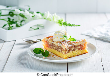 Tasty apple pie and ice cream with mint leaves