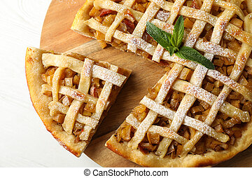 Tasty apple pie on white wooden background, top view. Homemade food