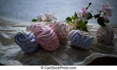 Tasty assortment of marshmallows on craft paper