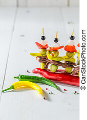 Tasty banderillas with peppers, olives and anchovies for spanish corrida