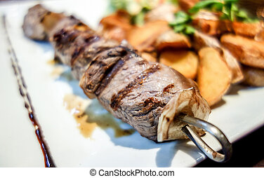 tasty beef steak kabobs with Golden French fries