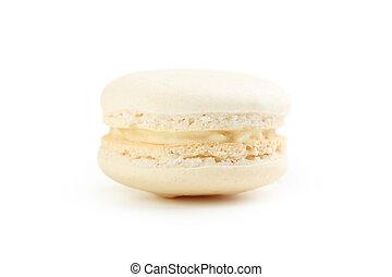 Tasty beige macaron isolated on white