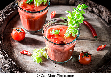 Tasty bloody mary cocktail with fresh tomatoes