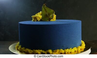 tasty blue cake decorated with dried pear - tasty blue round...