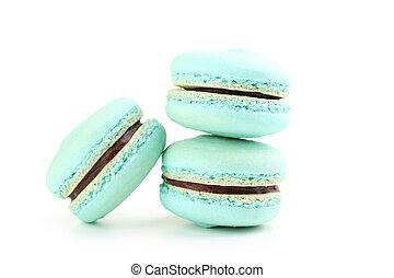 Tasty blue macarons isolated on white