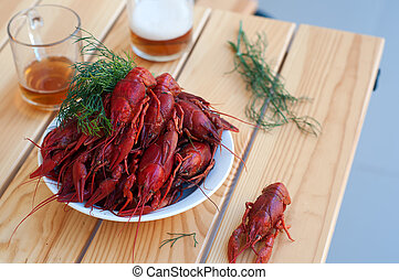 Tasty boiled crayfishes and beer on old table - Boiled...