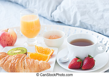 Tasty breakfast in bed