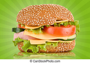 Burger with ham cheese tomatoes cucumbers and lettuce