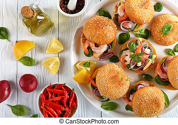 tasty burgers or pinchos with seafood