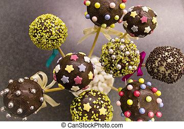 Tasty cake pops on sticks