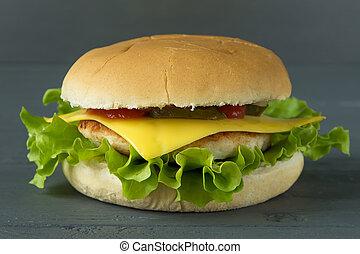 Tasty cheeseburger on gray wooden surface