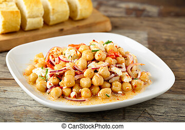 tasty chick pea salad with feta cheese, red onions and herbs