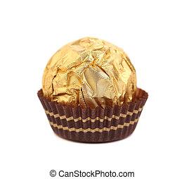 Tasty chocolate bonbon in golden foil.
