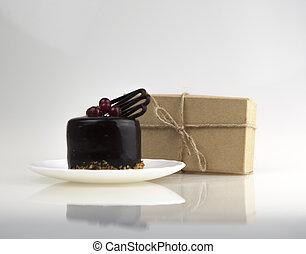 Tasty chocolate cake on white background