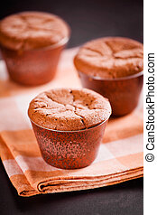 Tasty Chocolate Souffles - Close up photograph of three...