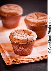 Tasty Chocolate Souffles - Close up photograph of three...