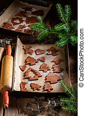 Tasty Christmas gingerbread cookies on baking tray
