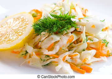 Tasty coleslaw - Cabbage salad with lemon and dill on white ...
