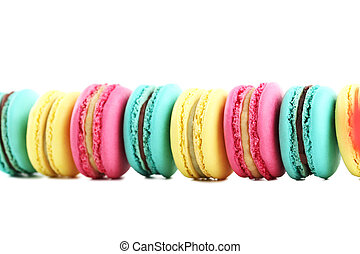 Tasty colorful macarons on white background