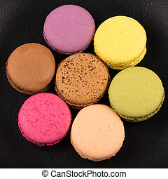 Tasty colorful macaroon close up for background