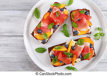 tasty colorful open sandwiches with meat