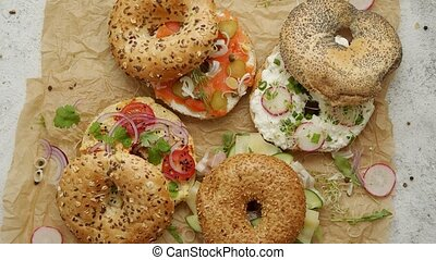 Tasty colorful various bagels with healthy ingredients ...