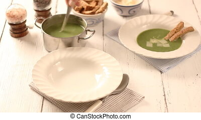 Tasty creamy spinach soup seasoned with crackers made from...