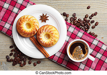 Tasty cupcake and cup of coffee