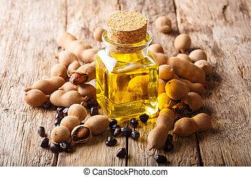 Tasty diet tamarind oil in a glass jar close-up. horizontal...