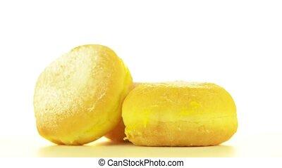 Tasty donuts rotating on white background.