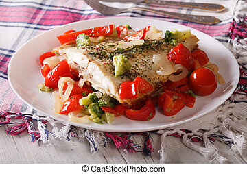 Tasty flounder with seasonal vegetables close-up. horizontal...