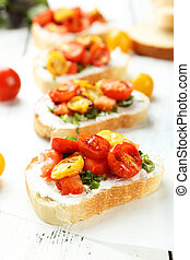 Tasty fresh bruschetta with tomatoes on white wooden background