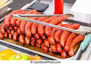 Tasty fried sausages on a tray in the dining room
