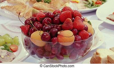 Tasty fruit - peaches, cherries, cherry on table.