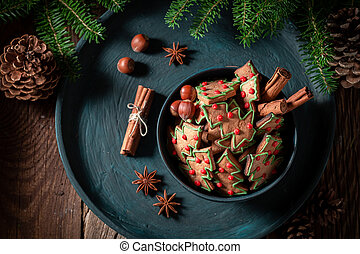 Tasty gingerbread cookies for Christmas with pinecone