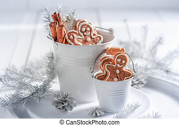 Tasty gingerbread man for Christmas in white bucket