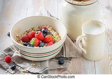 Tasty granola with fresh fruits for breakfast