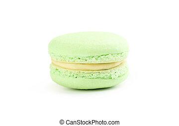 Tasty green macaron isolated on white