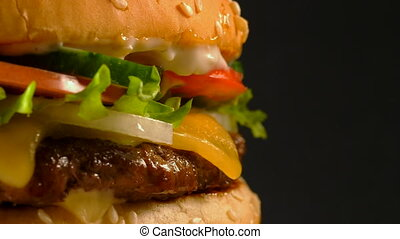 Tasty grilled beef burger with patty, onion, vegetables,...
