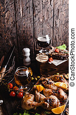tasty grilled meat with vegetables and beer on wooden background