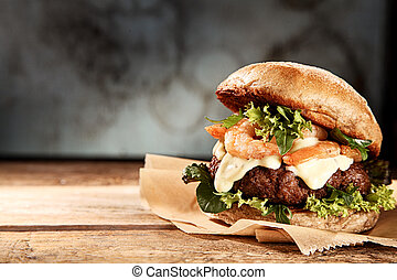 Tasty grilled prawn and beef burger with lettuce and ...
