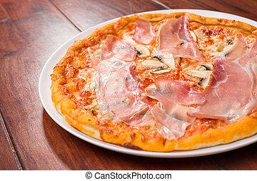 tasty ham and mushroom pizza