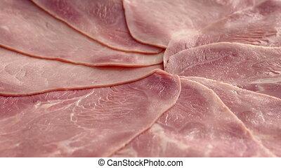 Tasty Ham Slices Rotating - Closeup of ham slices turning...