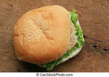 Tasty hamburger on a wooden vintage.