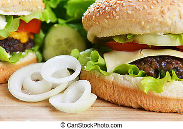 Tasty hamburger - Tasty and appetizing hamburger on wooden...