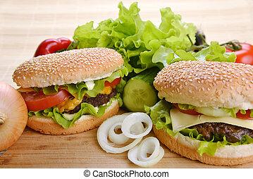 Tasty hamburger - Tasty and appetizing hamburger on wooden ...