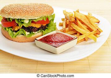 Tasty hamburger - Tasty and appetizing hamburger with fries...