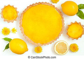 Tasty homemade backed lemon tart pie dessert with narcissus...