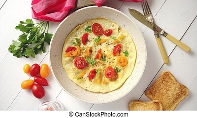 Tasty homemade classic omelet with cherry tomatoes, cheese ...
