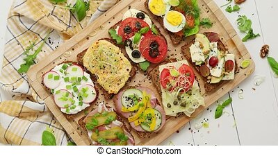 Tasty, homemade small sandwiches with various ingredients ...
